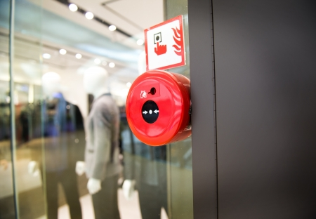 control center: Fire alarm on the wall of shopping center. Stock Photo