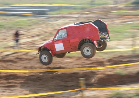 Driver competing in an off-road 4x4 competition. Stock Photo - 20027080