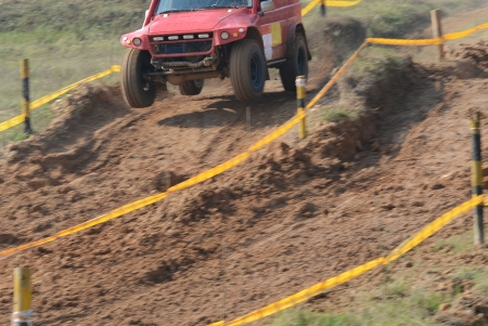 Driver competing in an off-road 4x4 competition. Stock Photo - 20027529