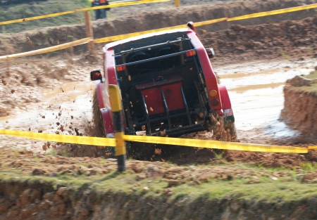 Driver competing in an off-road 4x4 competition. Stock Photo - 20027574