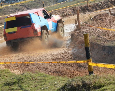 four wheel drive: Driver competing in an off-road 4x4 competition.