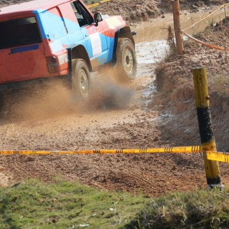 Driver competing in an off-road 4x4 competition. Stock Photo - 20027467