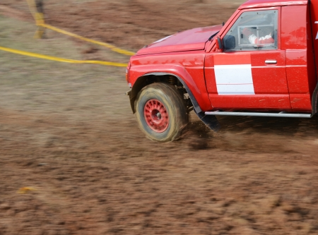 Driver competing in an off-road 4x4 competition. photo