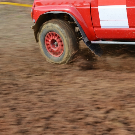 Driver competing in an off-road 4x4 competition. Stock Photo - 20025577