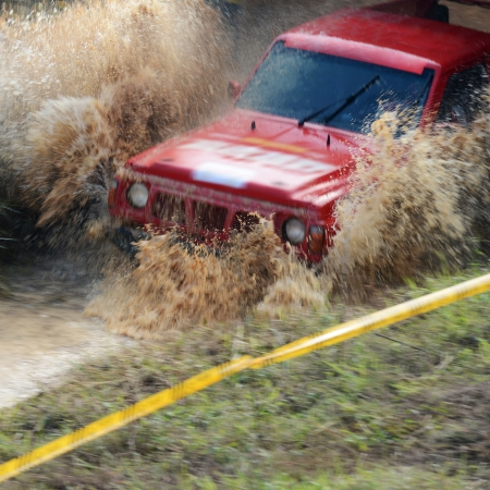 4wd: Driver competing in an off-road 4x4 competition.