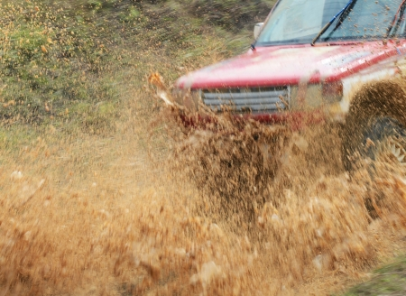 Driver competing in an off-road 4x4 competition. Stock Photo - 20027401