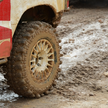 4x4: close-up shot of wheel in dirt.  Stock Photo