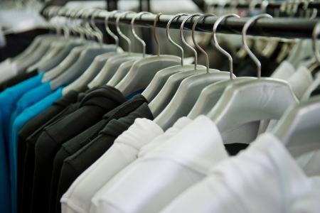 fashion clothing on hangers at the show photo