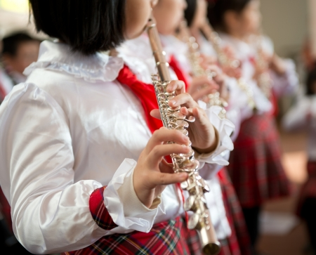 playing music: The pupils playing the flute.