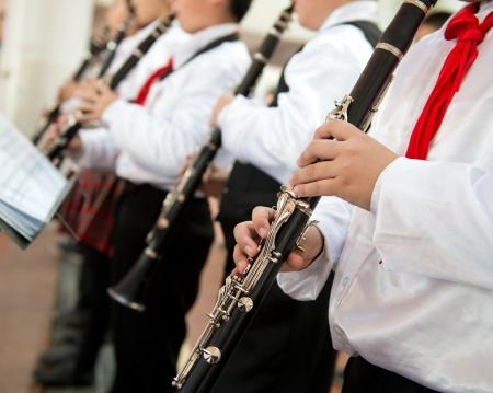 clarinete: Los alumnos tocando el clarinete. Foto de archivo