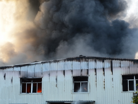 dynamic heat black: Fire burning and black smoke over the house.
