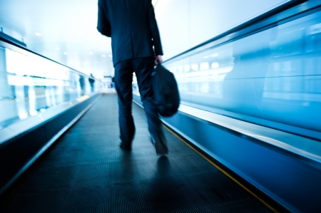 corporate travel: movement of abstract escalator with people.