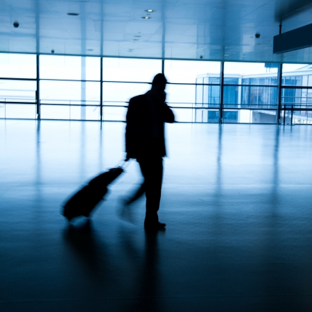 business lounge: Walking passenger at the airport, motion blur.  Stock Photo