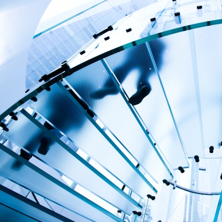 staircase structure: Silhouette people on glass staircase Stock Photo