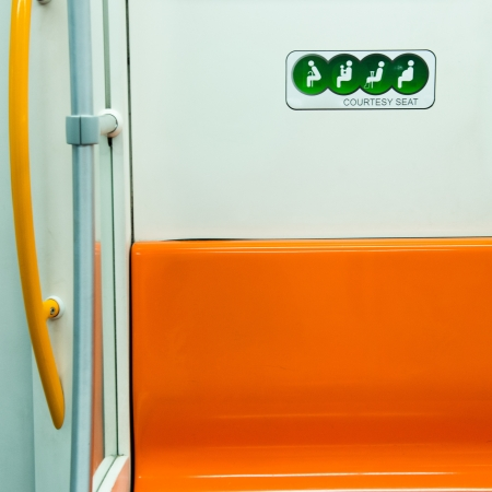 courtesty seat in a  modern subway car, which nearby the door. photo