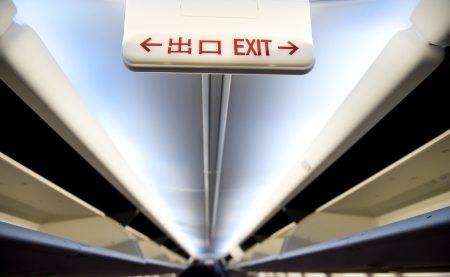 airplane interior with exit sign.  photo