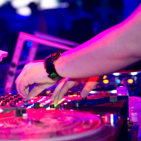 dancing disco: Dj mixing in nightclub at party. Stock Photo