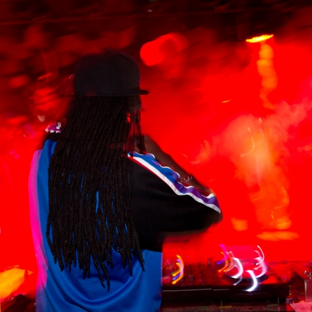 Singing dj at a night club.  photo