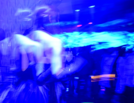Cheerful women dancing at the night club. photo