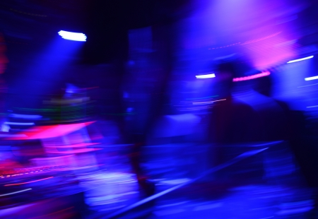 music hall: abstract dancing people motion blur effect in the nightclub. Stock Photo