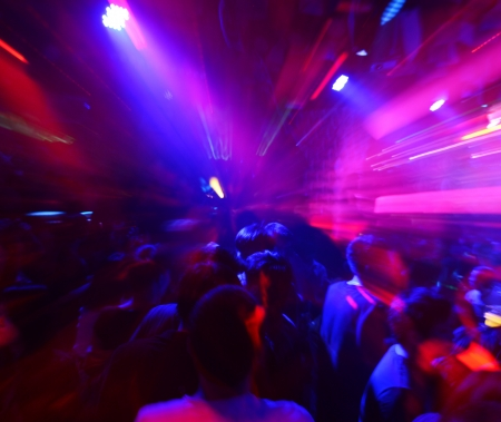 nightclub crowd: Dancing people in a disco, cheery party.