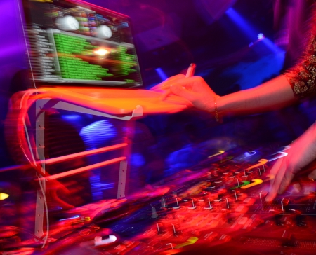 Dj mixing in nightclub at party. Imagens