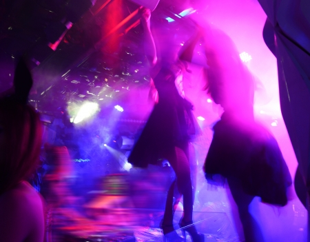 concert hall: Dancing people in a disco, cheery party.