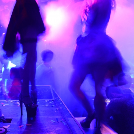 Dancing people in a disco, nightclub. photo