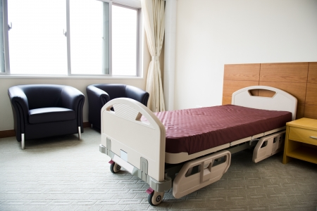 hospital room: Clean empty bed in a hospital ward