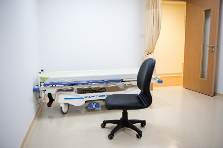 sickroom: hallway in hospital with bed.