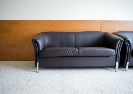 front office: Modern leather sofa in a room. Stock Photo