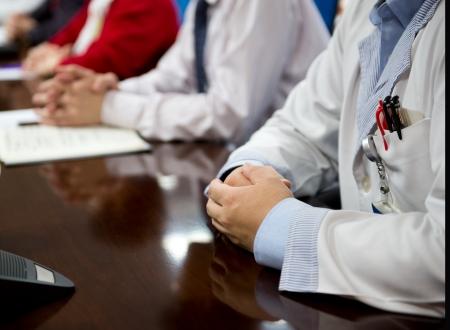 clinician: Closeup of doctors at medical conference.