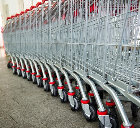 Many empty shopping carts in a row. photo