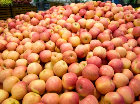 big apple: Pile of apples on a market for sale. Stock Photo
