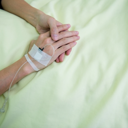 Close up of a iv drip in patients hand. photo
