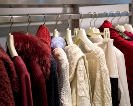 clothing rack: fashion clothing on hangers at the show