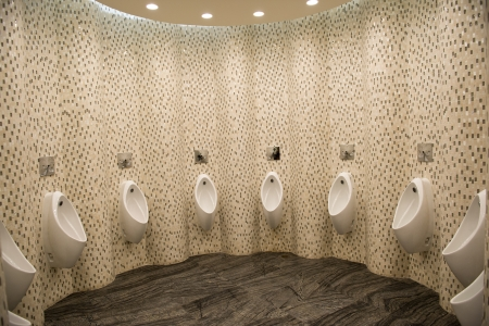 Group of porcelain urinals in public toilets. Stock Photo - 22826322