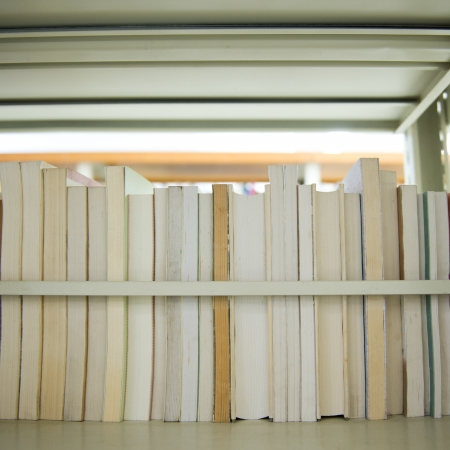 case: Close up of books in bookshelf. Stock Photo