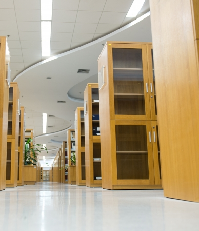file cabinet: Interior of library with book shelves and books.