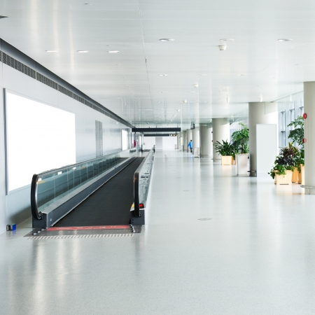 glass ceiling: Blank billboard and modern escalator at a international airport