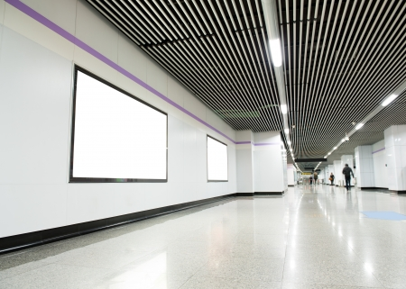 Blank billboard at an  underground passage.  photo