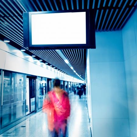 Blank billboard at an  underground passage.