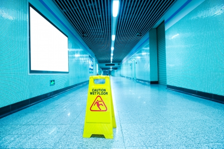 clean floor: Wet floor caution sign on subway station floor. Stock Photo