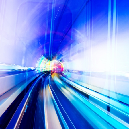light zoom: Abstract train moving in tunnel. Stock Photo