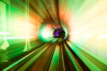acceleration: Abstract train moving in tunnel. Stock Photo