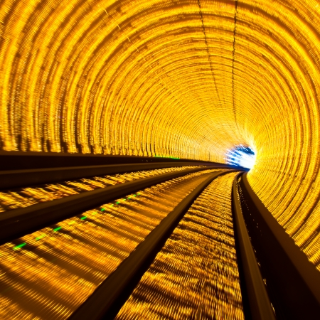 train tracks: Abstract train moving in tunnel. Stock Photo
