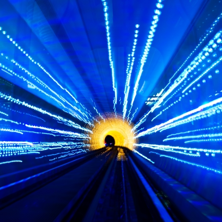 electric line: Abstract train moving in tunnel. Stock Photo