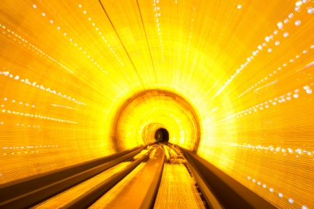 railway track: Abstract train moving in tunnel. Stock Photo