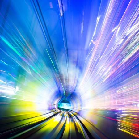 gateway: Abstract train moving in tunnel. Stock Photo