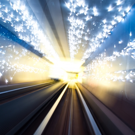 Abstract train moving in tunnel. photo